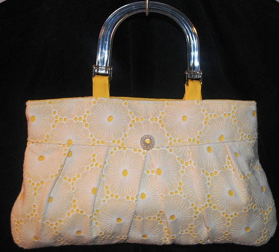 White eyelet and yellow purse with acrylic handles