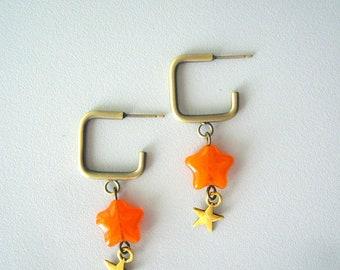 Orange star earrings