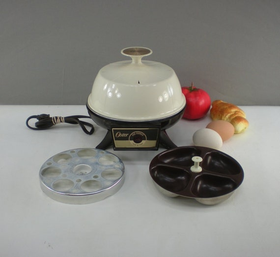 Oster 581 electric egg cooker poacher appliance for Decor 4 egg poacher