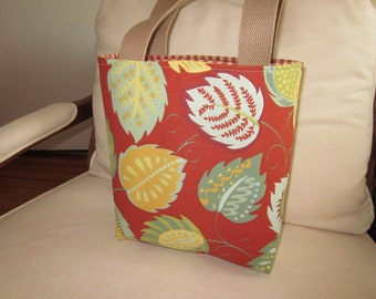Red background with whimsical, fun, multi color leaf design