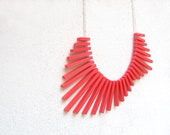minimal geometric necklace with neon red sticks and frosted white beads