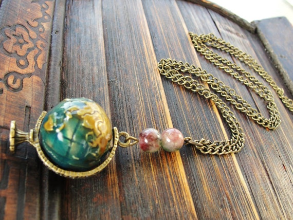 Super cool spinning globe necklace