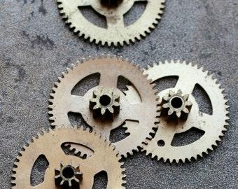 Vintage clock brass gears -- set of 4 -- D16
