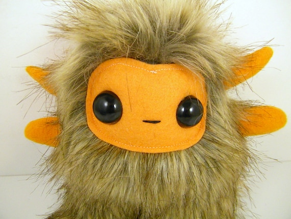 Shep the horned monster plush brown and bright orange stuffed animal