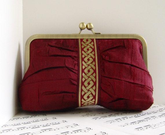 Dark red burgundy silk clutch with gold trim, Gathered clutch bag in frame, Ruched clutch