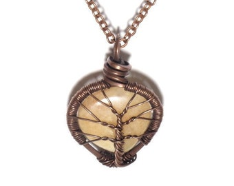 The Encased Peach Aventurine Tear Drop Tree of Life Necklace in Antique Copper.