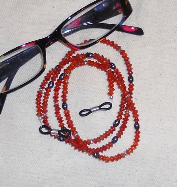 Orange and silver carnelian and hematite eyeglass chain holder semiprecious stone jewelry packaged in a gift bag 1144