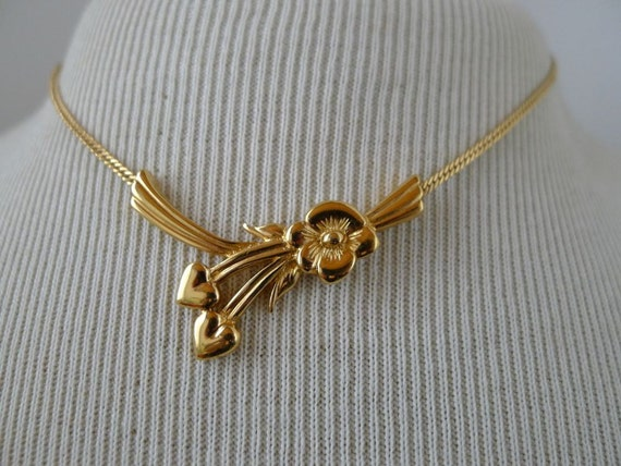 Monet gold tone petite flower necklace