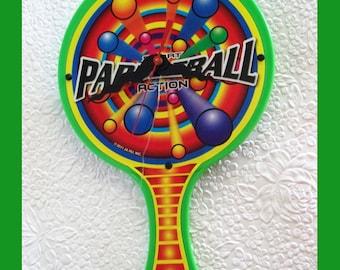 Paddle Ball Wall Clock