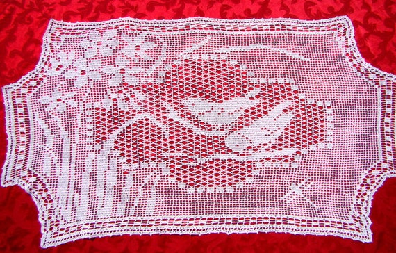 Filet crocheted Chickadees preparing their new spring home table runner
