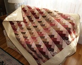 Braided lap quilt in pinks and browns