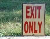 Exit only sign made from reclaimed plywood