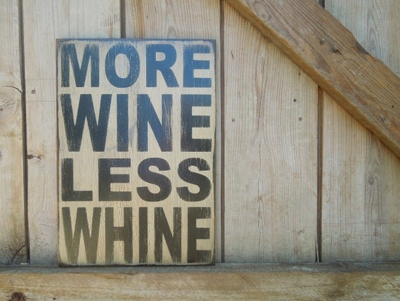 Wooden sign made from reclaimed plywood More wine less whine