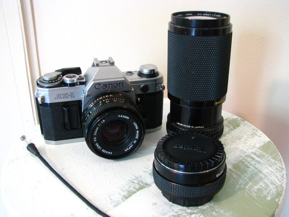 Near Mint Canon AE-1 Camera with FD 50mm, Zoom Lens, Teleconverter and More