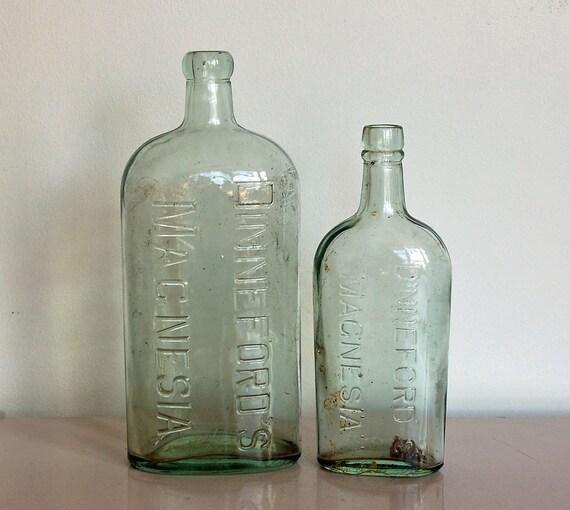 Glass bottles vintage antique aqua british medicine by for Uses for old glass bottles