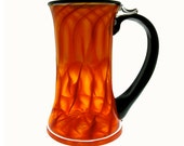 Hand Blown vibrant orange and black Glass Mug