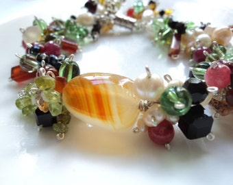 Mixed gemstone chunky statement silver bracelet.