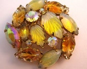 Shades of yellow and topaz brooch with art glass stones.
