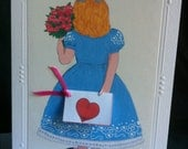 All Occasion Greeting Cards, Alice is standing with her own card