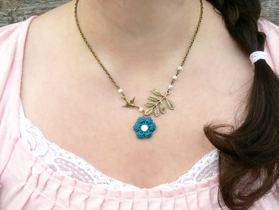 Crochet Flower Necklace with Aqua Teal Cotton Thread, a Swallow Bird, and a Leaf Charm on an Antique Bronze Chain with Mini Pearls: