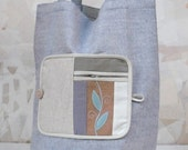 Indian Summer Fold-up Leafy  Eco Shopping Bag made from lilac linen fabric ornamented with leafy motif on a wool felt base.
