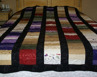 Full/QueenStrips of Color size Quilt using shades of red, purple, gree, tan and white jelly rolls from Moda