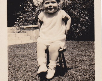VTG B&W Photo of Cheerful Lil Girl In Chair On The Lawn