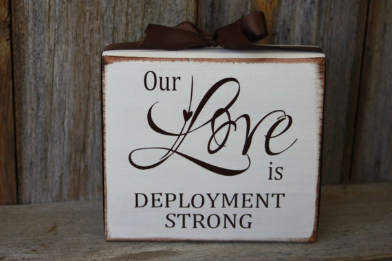 Our Love is deployment strong- military, military wife, wood block with vinyl lettering decal and ribbon
