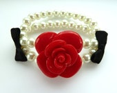Rose pearl bracelet - Large red rose and glass pearl bracelet with black satin bows, stretchy elasticated ruby off-white