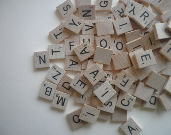loose scrabble tiles 60 plus pieces . scrabble vowels included