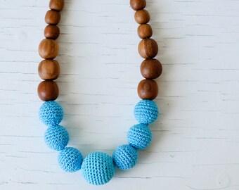 Solid Color Nursing Necklace in bright blue, apple wood