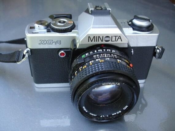 Vintage Minolta XG- A 35MM Camera- We have a huge selection of vintage cameras