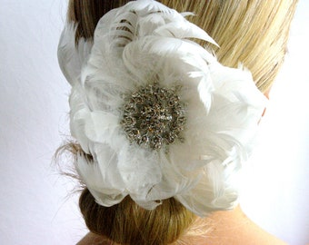 White bridal hair accessory. Huge crystal and feather fascinator. Exquisite wedding crystal fascinator. Snow white feather hair piece.