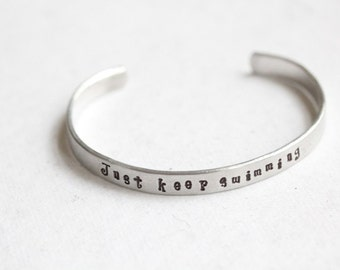 "Disney ""just keep swimming"" Hand stamped Cuff"