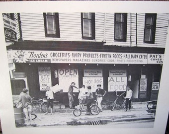 """Vintage black and white art print grocery store street scene 1970's city shop decor Boys Bicycles 8.5"""" by 11"""" unframed picture card stock"""