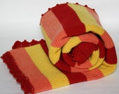 Knit baby blanket striped with crocheted edge. Crib or stroller size. Red, yellow, tangerine. Soft wool