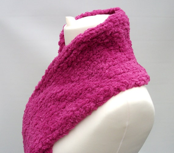 Pink scarf knitted in soft yarn.