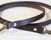 "Long leather strap with a swivel snap hook (at each end) - 20"" long x 1/2"" wide"