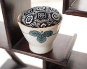 Silk kimono pin cushion in a vintage Japanese sake cup -geometric, black, white