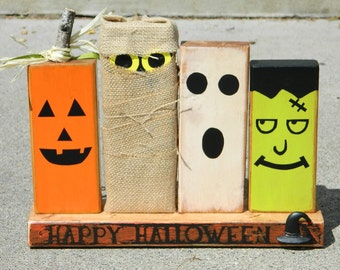 Primitive Halloween decoration with wooden monsters pumpkin ghost Frankenstein and ghoul happy halloween Fall decor boo autumn monster decor