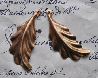 Two feathery leaf stampings with hoop for hanging