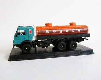 VINTAGE metal Soviet MILK TRUCK. Use for mixed media art, photography projects, assemblage, etc.