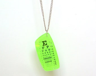 Neon green eye chart pendant and chain made from prescription Rx lens
