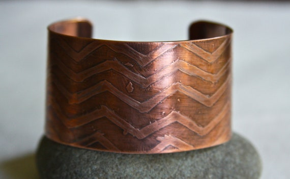 Copper cuff bracelet that is etched with a one of a kind Chevron designs