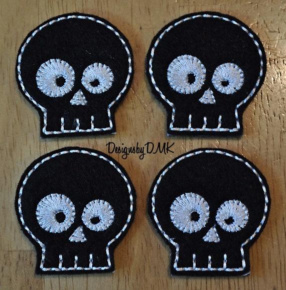 Items similar to goofy skeleton head on black felt for Felt arts and crafts