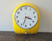 Vintage Yellow Poole Electrical Wall Clock, 1950's