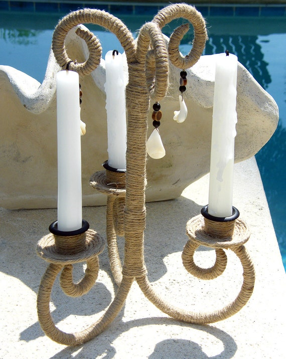Jute covered table top rod iron candelabra adorned with seashell and natural beads for a coastal theme