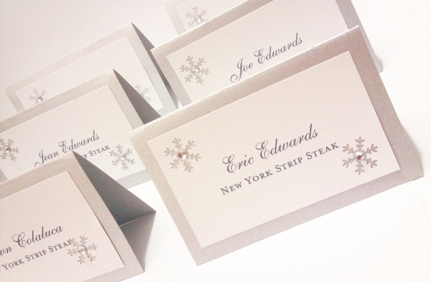 Escort cards winter wedding snowflake place by for Place card for wedding