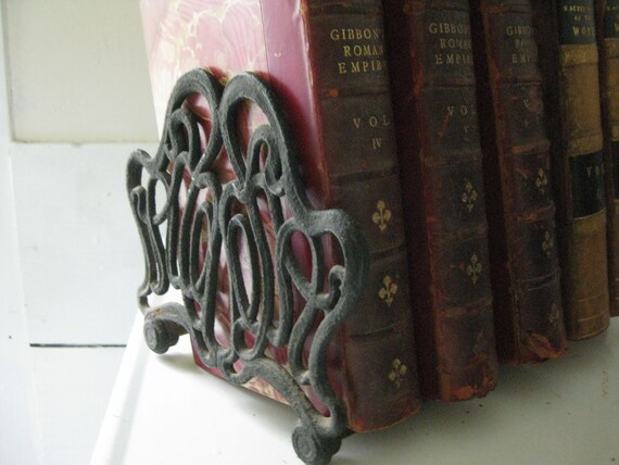 antique iron book ends - adjustable and appropriate for the athenaeum