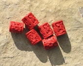 Cinnabar barrel beads with vivid floral imprint